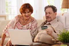 Elderly couple shopping online Stock Images