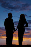 Elderly couple silhouette hold hands Stock Photos