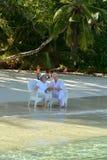 Elderly couple sitting on a beach Stock Photo