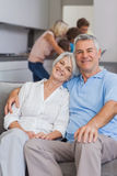 Elderly couple sitting on the couch Stock Photo