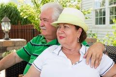Free Elderly Couple Sitting Gazing Into The Distance Stock Photo - 42270820