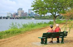 Elderly Couple Sitting at the Park Stock Photo