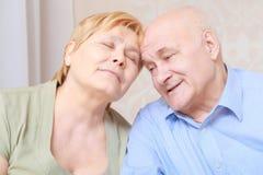 Elderly couple sitting together Stock Photography
