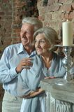 Elderly couple sitting in vintage interior Royalty Free Stock Photo