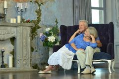 Elderly couple sitting in vintage interior Stock Images