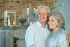 Elderly couple sitting in vintage interior Stock Photo
