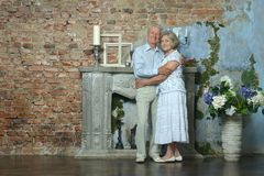 Elderly couple sitting in vintage interior Royalty Free Stock Images
