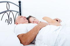 Elderly couple sleeping in bed. Royalty Free Stock Photography