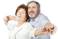 Elderly couple smiles and holds hands Royalty Free Stock Images