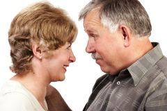 Elderly couple smiling. Happy elderly loving couple smiling. Mature couples in love series royalty free stock images