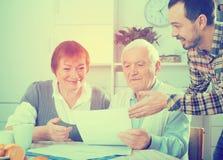 Elderly couple and social employee Stock Image
