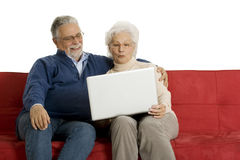 Elderly couple on the sofa Royalty Free Stock Photography