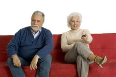 Elderly couple on the sofa Stock Photos