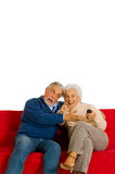 Elderly couple on the sofa Royalty Free Stock Images