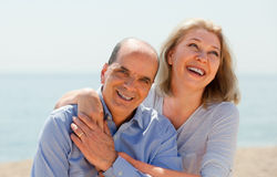 Elderly couple spends time. On beach Royalty Free Stock Image