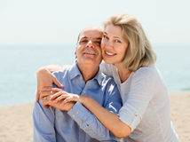 Elderly couple spends time on seaside Royalty Free Stock Photography