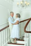 Elderly couple on stairs Royalty Free Stock Photography