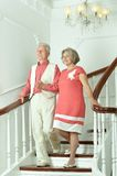 Elderly couple on stairs Royalty Free Stock Image