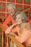 Elderly couple on stairs with railing Royalty Free Stock Photos