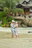 Elderly couple standing embracing outdoors Royalty Free Stock Photo