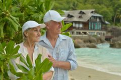 Elderly couple standing embracing outdoors Stock Photography