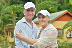 Elderly couple standing embracing outdoors Royalty Free Stock Images