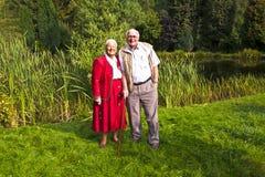 Elderly couple standing hand Stock Image