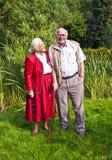 Elderly couple standing hand Royalty Free Stock Photos