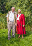Elderly couple standing hand Stock Photo