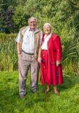 Elderly couple standing hand Stock Photo