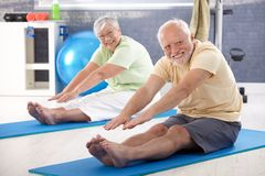 Elderly couple stretching royalty free stock photos