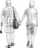 Elderly couple on the stroll Stock Images