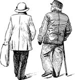 Elderly couple strolling Royalty Free Stock Photos