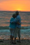 Elderly couple at sunset Stock Photos