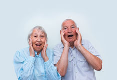 The elderly couple surprised by raising both hands Royalty Free Stock Image
