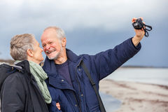 Elderly couple taking a self portrait Royalty Free Stock Image
