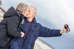 Elderly couple taking a self portrait Royalty Free Stock Image
