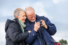 Elderly couple taking a self portrait Stock Photography