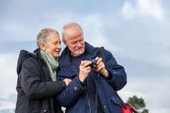 Elderly couple taking a self portrait Stock Photo