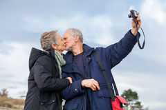 Elderly couple taking a self portrait Royalty Free Stock Images