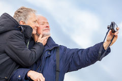 Elderly couple taking a self portrait Royalty Free Stock Photos