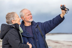 Elderly couple taking a self portrait Stock Images