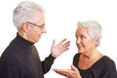 Elderly couple talking Stock Images