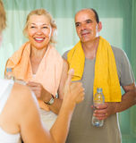 Elderly couple talking to trainer Royalty Free Stock Images