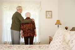 Elderly couple in their bedroom Royalty Free Stock Photography