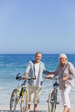 Elderly couple with their bikes stock photography
