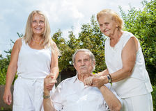 Elderly couple and their daughter Royalty Free Stock Images