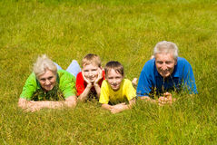 Elderly couple with their grandchildren Stock Image
