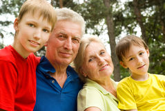 Elderly couple with their grandchildren Royalty Free Stock Images