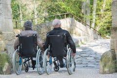 Elderly couple on their wheelchair royalty free stock photo